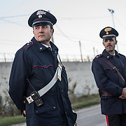 Italian police, carabineros outside the Cie in Palazzo San Gervasio, which is under construccion. The opening is expected for April 2015 and will have a capacity for 156 migrants
