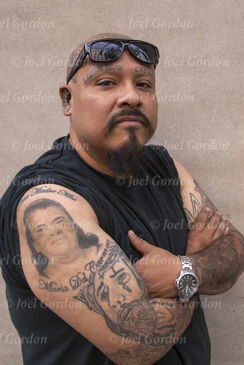 Andres Morales face and arms tattoo. Shaved eye brows with&quot; laugh now&quot; and &quot;cry later&quot; tattoos.<br />