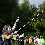 A shaman puts a spell on the Cuadrilla drill site. Anti-fracking activists join hands to surround the Cuadrilla fracking site. Thousands turned out for a march of solidarity against fracking in Balcombe. The village Balcombe in Sussex is the  centre of fracking by the company Cuadrilla. The march saw anti-fracking movements from the Lancashire and the North, Wales and other communities around the UK under threat of gas and oil exploration by fracking.