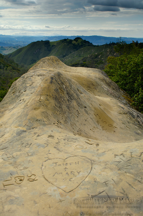 Public Graffiti vandalism carved in sandstone at Rock City, Mount Diablo State Park, California