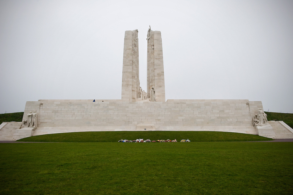 The front of the Canadian National Vimy Memorial dedicated to the memory of Canadian Expeditionary Force members killed in World War one. The monument is situated at a 100 hectare preserved battlefield with wartime tunnels, trenches, craters and unexploded munitions. The memorial designed by Walter Seymour Allward opened in 1936.