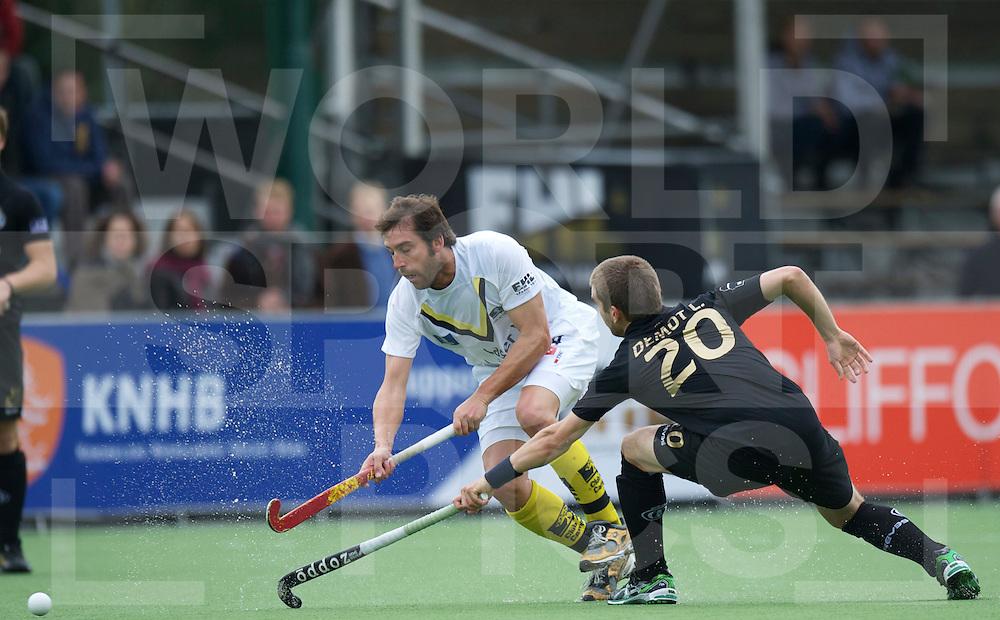 EINDHOVEN - EHL Hockey ronde 1.Campo Madrid v Bruxelles.foto: Edi Tubau (L) in duel with Lucas Demot (R)..FFU PRESS AGENCY COPYRIGHT FRANK UIJLENBROEK..