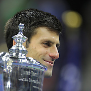 Novak Djokovic, Serbia, with the trophy after winning the Men's Singles Final against Roger Federer, Switzerland, during the US Open Tennis Tournament, Flushing, New York, USA. 13th September 2015. Photo Tim Clayton