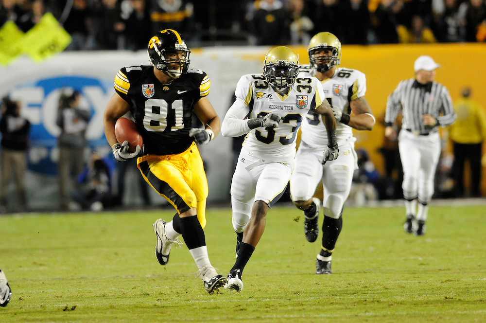 January 5, 2010: Tight end Tony Moeaki of the Iowa Hawkeyes runs upfield after making a catch as defensive back Mario Edwards gives chase during the NCAA football game between the Georgia Tech Yellow Jackets and the Iowa Hawkeyes in the Orange Bowl. The Hawkeyes were leading the Yellow Jackets 14-7 at halftime.