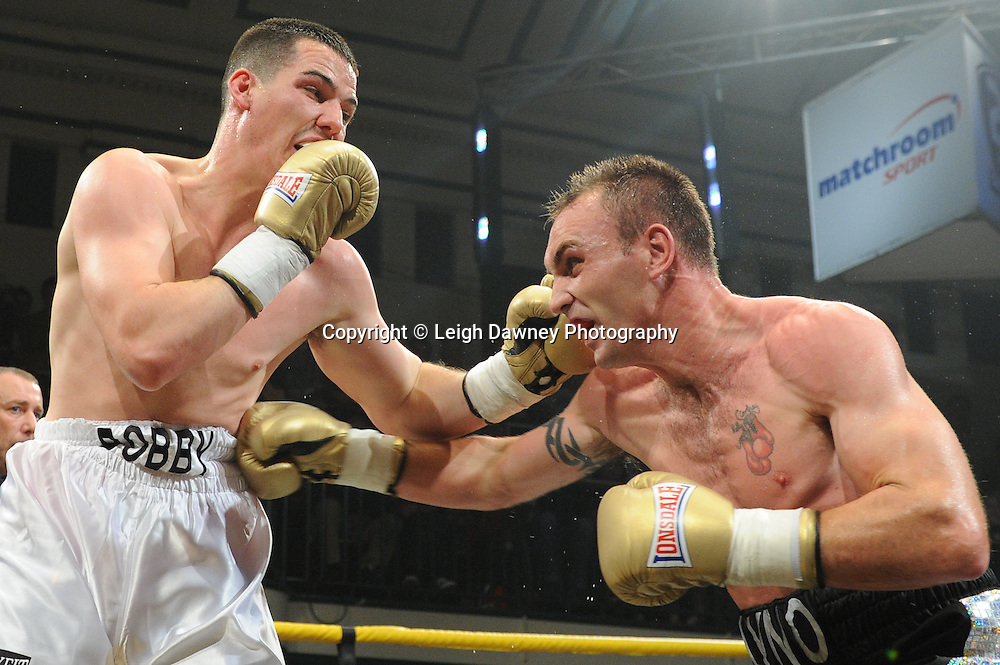 Colin Lynes (black shorts) defeats Bobby Gladman in Quarter Final Three at Prizefighter Welterweights II,York Hall, Bethnal Green ,London. Matchroom Sport/Prizefighter.Photo credit: Leigh Dawney 2011 07.06.11
