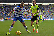 Reading's Carlos Orlando Sa holds off Brighton and Hove Albion midfielder Dale Stephens during the Sky Bet Championship match between Reading and Brighton and Hove Albion at the Madejski Stadium, Reading, England on 31 October 2015. Photo by Mark Davies.