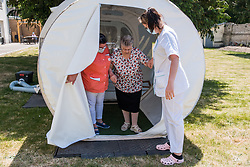 A resident leaves a bubble after a daughter visits her mother in a bubble at Fondation Shadet Vercoustre nursing home on May 27, 2020 in Bourbourg near Gravelines, France, where a double entry bubble has been installed to allow visits without risk of contamination, as part of a prophylactic measure against the spread of the Covid-19 disease caused by the novel coronavirus. Relatives and residents each enter the tent through a different entrance to find themselves in the same room, separated by a transparent plastic canvas. These bubbles were originally designed for tourism by the company. Photo by Julie Sebadelha/ABACAPRESS.COM