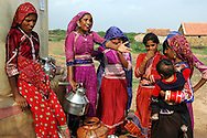 Maldhari girls fetching water from a modern well..Michael Benanav - mbenanav@gmail.com