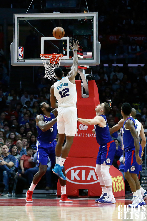 31 December 2017: Charlotte Hornets center Dwight Howard (12) goes for the baby hook over LA Clippers center DeAndre Jordan (6) during the LA Clippers 106-98 victory over the Charlotte Hornets, at the Staples Center, Los Angeles, California, USA.
