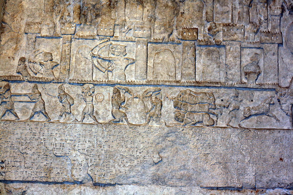 Assyrian relief. from Nimrud. Circa 8th century BC. Showing palace archers, soldiers, slaves and animals.