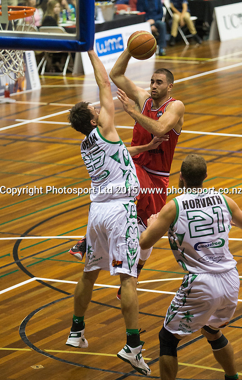 Ethan Rusbatch of the Rams takes a shot under pressure from Jeremiah Trueman of the Jets during the National Basketball League game between the Canterbury Rams v Manawatu Jets at Cowles Stadium in Christchurch. 10th April 2015 Photo: Joseph Johnson/www.photosport.co.nz