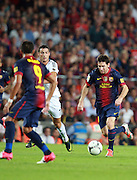 Lionel Messi in action during the Supercopa 1st leg match at the Nou Camp, Barcelona, Spain between FC Barcelona and Real Madrid on 23rd August 2012.