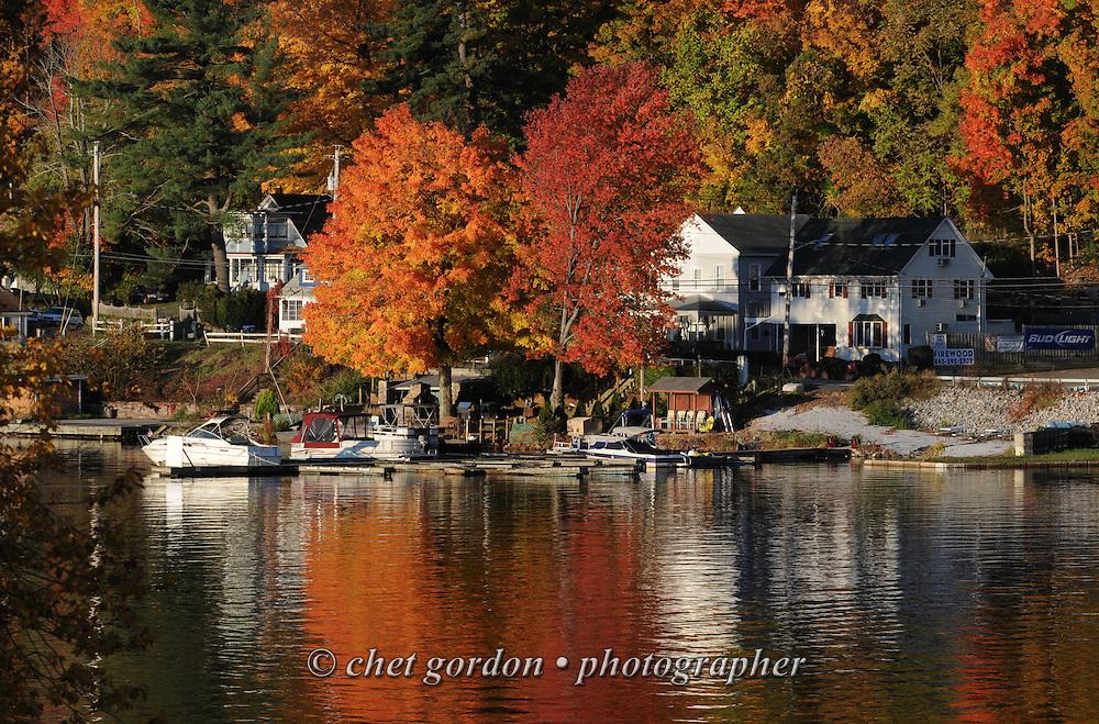 GREENWOOD LAKE, NY.  Fall foliage is reflected on the water in Greenwood Lake, NY on Sunday morning, October 21, 2012.  © Chet Gordon/THE IMAGE WORKS