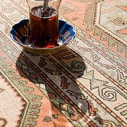 Glass of tea on a carpet, Turkey, Asia