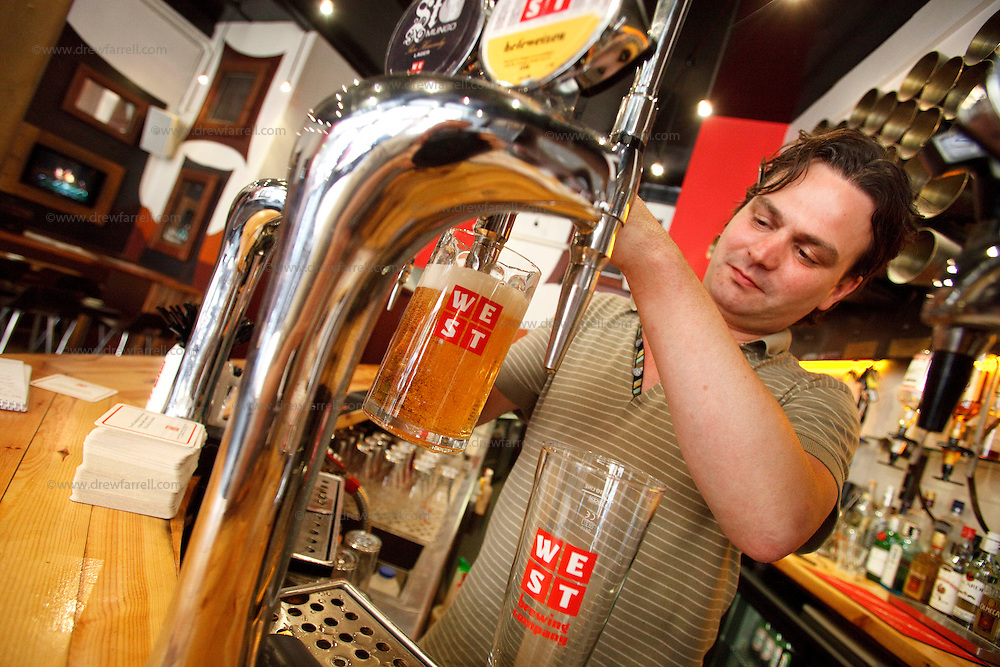 Picture shows : Detail WEST beer poured by manager Michael.  Bar 91 Candleriggs. Merchant City Area, Glasgow. Travel guide feature..Picture Drew Farrell. tel : 07721-735041......