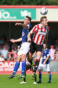 Paddy Lacey and  Kyle Storer during the Vanarama National League match between Cheltenham Town and Barrow at Whaddon Road, Cheltenham, England on 22 August 2015. Photo by Antony Thompson.