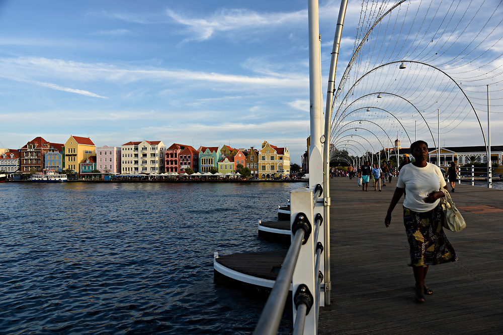 WILLEMSTAD, CURACAO - DECEMBER 12, 2014:  The instantly recognizable Curacao cityscape with its uniquely Dutch architecture facing Willemstad Harbor is seen from the Queen Emma Bridge, a walkable pontoon bridge, that goes across the Santa Anna Bay. (photo by Melissa Lyttle)