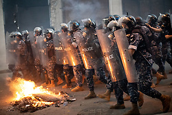© Licensed to London News Pictures. 10/08/2020. Beirut, Lebanon. Police and army clash with demonstrators as they protest against the government following a huge explosion in Beirut port on 4 August. Photo credit : Tom Nicholson/LNP