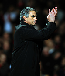 Jose Mourinho Manager waves goodbye to the Man United fans after the final whistle of the UEFA Champions League First Knockout Round Second Leg match between Manchester United and Inter Milan at Old Trafford on March 11 2009, in Manchester, England.