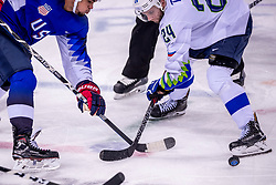 GANGNEUNG, SOUTH KOREA - FEBRUARY 14: forward Rok Ticar #24 of Slovenia, forward Jordan Greenway #18 of the United States  during Ice Hockey match between Slovenia and USA in the Men's Ice Hockey Preliminary Round Group B at Gangneung Hockey Centre on February 14, 2018 in Gangneung, South Korea. Photo by Ronald Hoogendoorn / Sportida