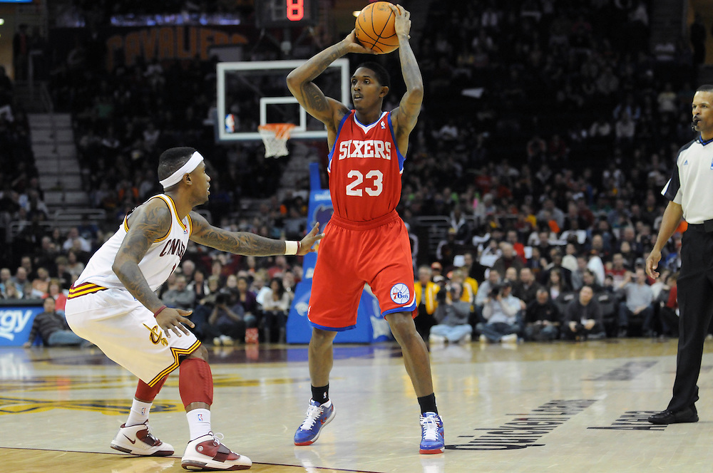 Feb. 27, 2011; Cleveland, OH, USA; Philadelphia 76ers point guard Lou Williams (23) looks for a pass over Cleveland Cavaliers point guard Daniel Gibson (1) during the fourth quarter at Quicken Loans Arena. The 76ers beat the Cavaliers 95-91.Mandatory Credit: Jason Miller-US PRESSWIRE