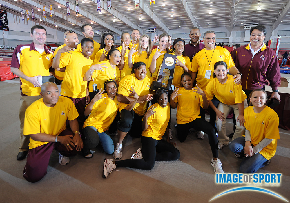 Mar 15, 2008; Fayetteville, AR, USA; The Arizona State women and coach Greg Kraft pose with the championship plaque after winning the team title for the second year in a row in the NCAA indoor track and field championships at the Randal Tyson Center.