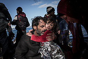 A family of migrants reacts moments after landing on the shores of Lesvos after crossing the Aegean sea from Turkey. FEDERICO SCOPPA/CAPTA
