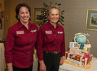 Kim Terrio and Penny Pitou celebrates their 40th year in business with a special cake from White Mountain Cupcake during their Travel Trade Show at the Margate on Saturday afternoon.   (Karen Bobotas/for the Laconia Daily Sun)