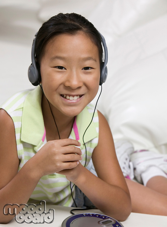 Young Girl Listening to Music on Headphones