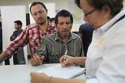 """Manuel Francisco Manuel, 53, from Nentón, Huehuetenango, signs up for complementary transport up to Huehuetenango City at the Migration Office in Guatemala City's La Aurora Airport after having been deported from the United States. Manuel, who has two sons who have been living many years in Nashville, Tennessee, claims this is the 15th time he has been deported. """"I have no land here, no money, so I will keep trying. My family is over there."""" Guatemala City, Guatemala. May 17, 2013."""