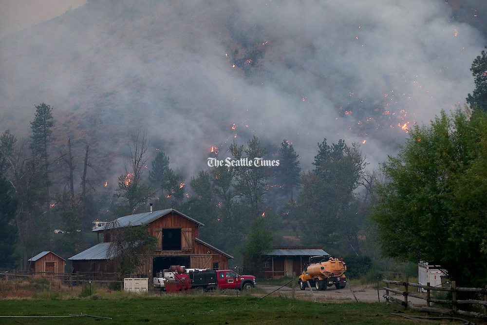 Fires burn near a ranch in Twisp. Thursday, Aug. 20, 2015.<br />