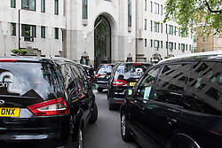 "Mayfair, London, May 24th 2016. Drivers from minicab operator Addison Lee bring traffic to a standstill in Berkely Square, outside of the offices of owner Carlyle Group, in protest against new ""unfair"" pay rates as the company battles to compete with cut-price Uber, with some drivers claiming they are earning as little as £4.99 per hour. PICTURED: Minicabs sound their horns outside Landsdowne House, where Carlyle Group is headquartered."