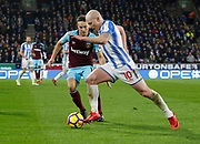 Huddersfield Town's Aaron Mooy  during the Premier League match between Huddersfield Town and West Ham United at the John Smiths Stadium, Huddersfield, England on 13 January 2018. Photo by Paul Thompson.