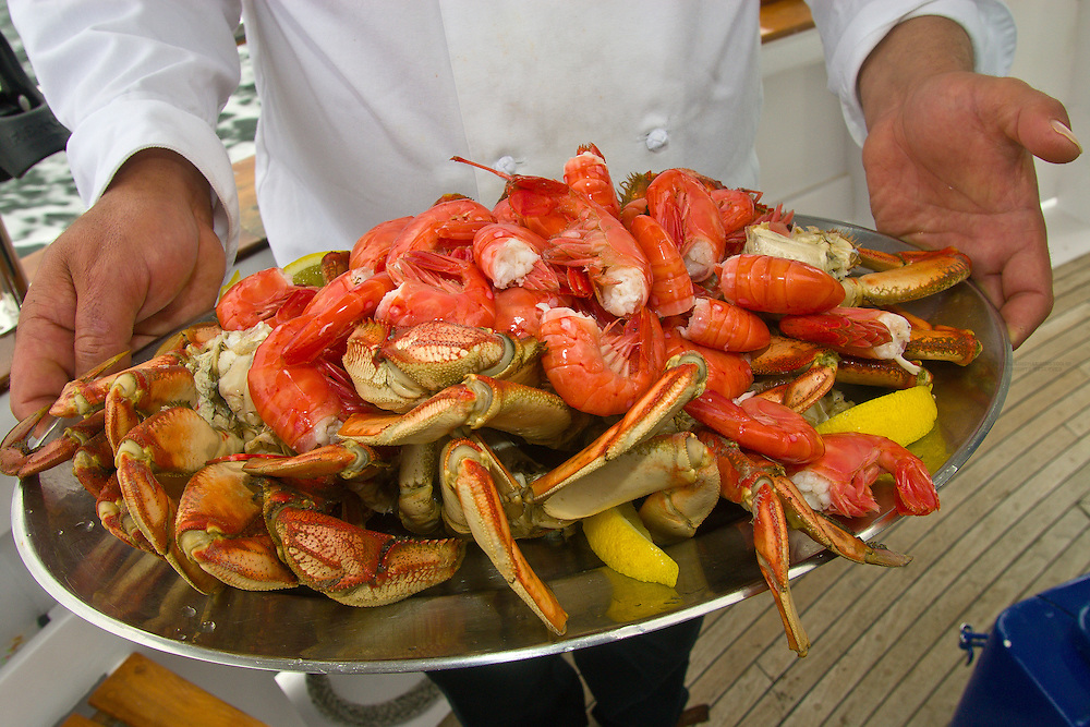 A plate of freshly caught shrimp and Dungeness Crab being served for lunch aboard the M/V Ursa Major in the waters of Southeast Alaska, near Sitka.