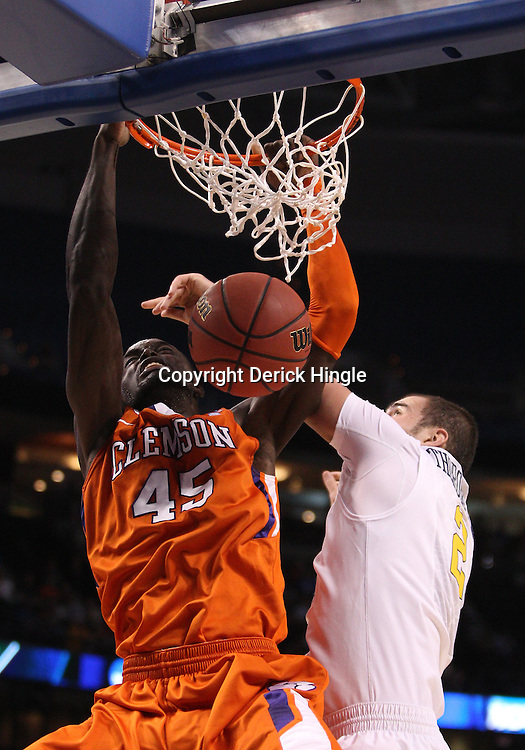 Mar 17, 2011; Tampa, FL, USA; Clemson Tigers forward/center Jerai Grant (45) dunks over West Virginia Mountaineers forward Cam Thoroughman (2) during the first half of the second round of the 2011 NCAA men's basketball tournament at the St. Pete Times Forum.  Mandatory Credit: Derick E. Hingle