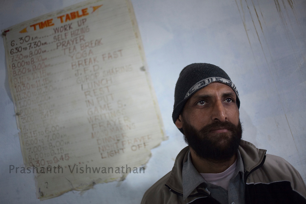"An addict Sukhdeep Singh is seen infront of a poster announcing their daily schedule at ""Navjeevan"" drug rehabilitation center in Amritsar, India, on Wednesday, December 15, 2010. Photographer: Prashanth Vishwanathan/HELSINGIN SANOMAT"