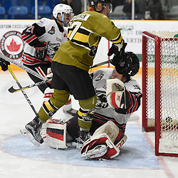 TRENTON, ON  - MAY 4,  2017: Canadian Junior Hockey League, Central Canadian Jr. &quot;A&quot; Championship. The Dudley Hewitt Cup. Game 5 between Powassan Voodoos and the Georgetown Raiders. Parker Bowman #17 of the Powassan Voodoos collides with Josh Astorino #1 of the Georgetown Raiders during the second period.<br /> (Photo by Andy Corneau / OJHL Images)