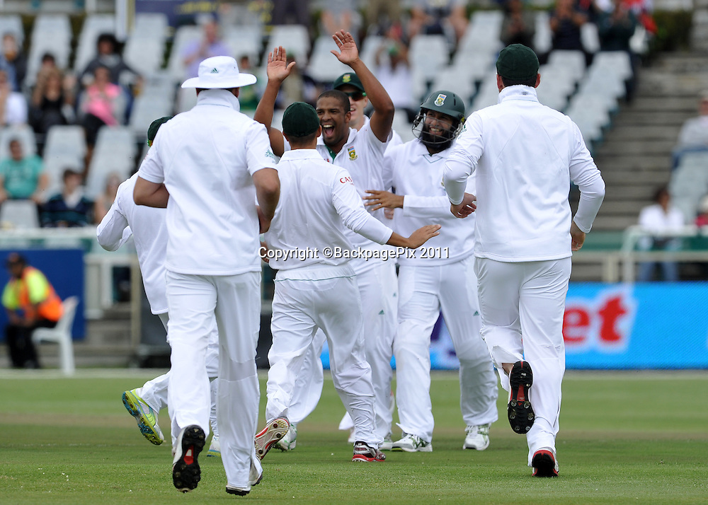 Vernon Philander of South Africa celebrates his first test wicket with his teammates. South Africa v Australia, first test, day 1, Newlands, South Africa. 9 November 2011.<br /> <br /> &copy;Ryan Wilkisky/BackpagePix