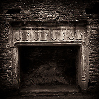 Fireplace in medieval castle ruins. Beupre Castle, Wales
