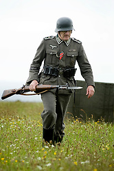 Member of the Northern World War Two Association portraying a soldier from 8th Company 2nd Battalion Grossdeutschland Division German Army with fixed bayonet and K98 rifle . Scarborough Castle Saturday 29th May 2010 .<br />
