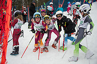 Madeleine Baron, Roe Beland, Summer Flannery and Libby Maloney have some fun before the start of the first annual Candy Man Cup stubby slalom with Gunstock Ski Club in honor of their long time coach Dan Wheeler.  (Karen Bobotas/for the Laconia Daily Sun)