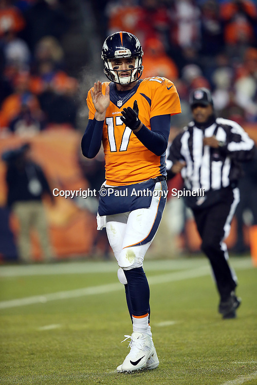 Denver Broncos quarterback Brock Osweiler (17) claps after a penalty call on the opposing team during the 2015 NFL week 16 regular season football game against the Cincinnati Bengals on Monday, Dec. 28, 2015 in Denver. The Broncos won the game in overtime 20-17. (©Paul Anthony Spinelli)