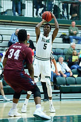 17 November 2017:  Jaylen Beasley lines up a jumper over Kevin Gamble during an College men's division 3 CCIW basketball game between the Alma Scots and the Illinois Wesleyan Titans in Shirk Center, Bloomington IL