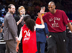 File photo dated february 14, 2016 of Los Angeles Lakers Kobe Bryant (24) high-fives his daughter Gianna on the court in warm-ups before first half NBA All-Star Game basketball action in Toronto, ON, Canada. Kobe Bryant, the 18-time NBA All-Star who won five championships and became one of the greatest basketball players of his generation during a 20-year career with the Los Angeles Lakers, died in a helicopter crash Sunday. Bryant's 13-year-old daughter Gianna also was killed. Photo by Mark Blinch/CP/ABACAPRESS.COM