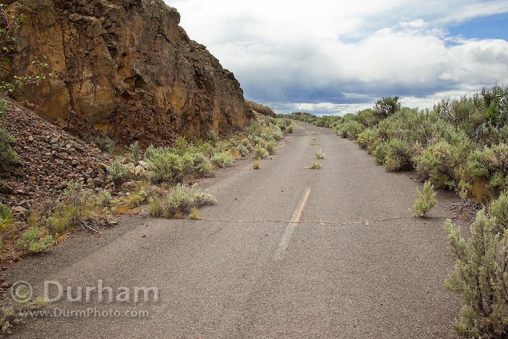 A crumbling old abandoned highway cutting through the desert of Central Washington.