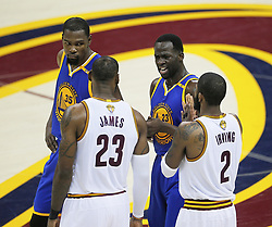 The Golden State Warriors' Draymond Green argues with the Cleveland Cavaliers' LeBron James while Stephen Curry, not pictured, shoots foul shots in the second quarter during Game 4 of the NBA Finals at Quicken Loans Arena in Cleveland on Friday, June 9, 2017. (Photo by Leah Klafczynski/Akron Beacon Journal/TNS) *** Please Use Credit from Credit Field ***