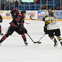 "TRENTON, ON  - MAY 5,  2017: Canadian Junior Hockey League, Central Canadian Jr. ""A"" Championship. The Dudley Hewitt Cup. Game 7 between Georgetown Raiders and the Powassan Voodoos. Jordan Anderson #25 of the Georgetown Raiders battles for the puck with Dayton Murray #20 of the Powassan Voodoos during the first period.<br /> (Photo by Andy Corneau / OJHL Images)"