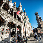 Ornate buildings in the Markt (Market Square) in the historic center of Bruges, a UNESCO World Heritage site. At left is the Proincial Court building. At right is the Belfry.