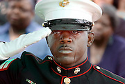"Marine Sgt. Eric Hargrave cries as ""Taps"" is played for his cousin, US Army Spc. James Marshall, during his burial Tulsa, OK. Marshall was killed by an IED while serving in Iraq."