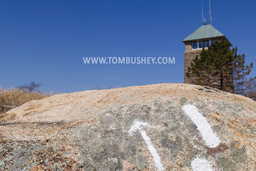 Bear Mountain, New York - Trail markers on a rock point to Perkins Memorial Tower at Bear Mountain State Park on April 13, 2015.